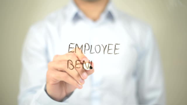 employee benefit, man writing on transparent screen - indennità video stock e b–roll
