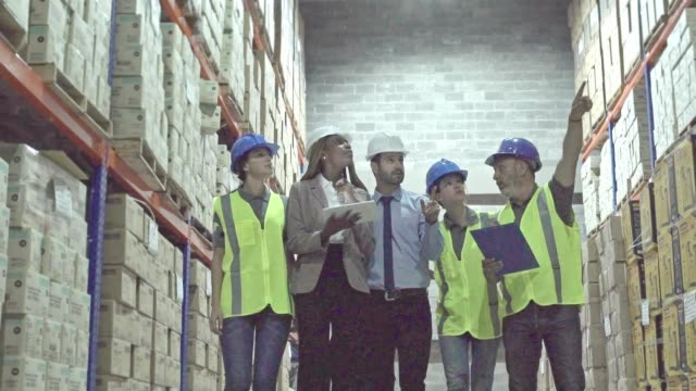 Employee indicating the work to be done in the warehouse