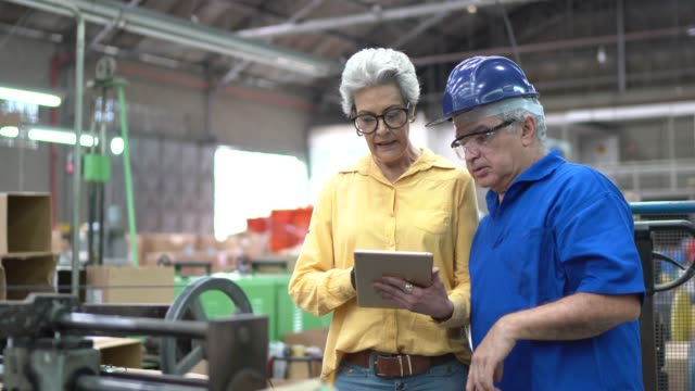 Employees using tablet in the industry Employees using tablet in the industry production line worker stock videos & royalty-free footage