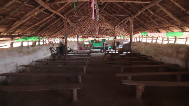 empty african church building with benches - sudan del sud video stock e b–roll