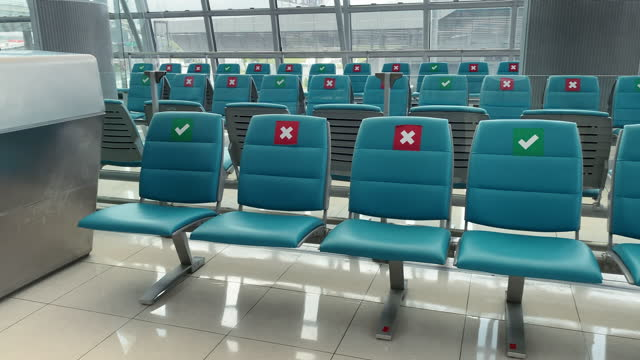 Empty airport waiting room with social distancing symbol on chairs stock video