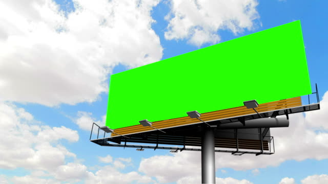 empty billboard with chroma key green screen, on blue sky with clouds, timelapse movement, advertisement empty billboard with chroma key green screen, on blue sky with clouds, timelapse movement, advertisement concept billboard stock videos & royalty-free footage