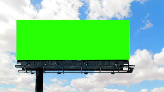 empty billboard with chroma key green screen, on blue sky with clouds time-lapse, advertisement