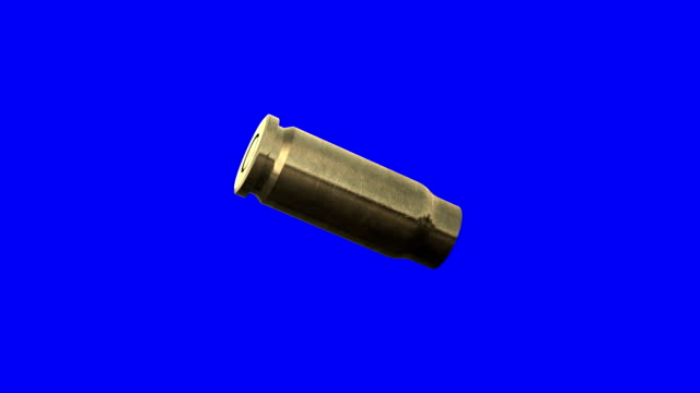 Empty Bullet Shell Rotating on a Blue Screen Background. Used for Shooting Scenes video