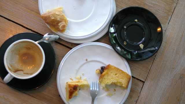 Empty Coffee Cups And Plates With Desserts After Breakfast Empty Coffee Cups And Plates With Desserts After Breakfast. Closeup. 4K. leftovers stock videos & royalty-free footage