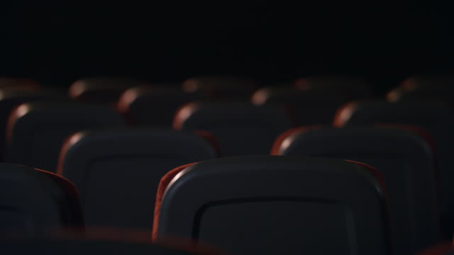 Empty comfortable seats in cinema. Theatre hall with empty armchairs