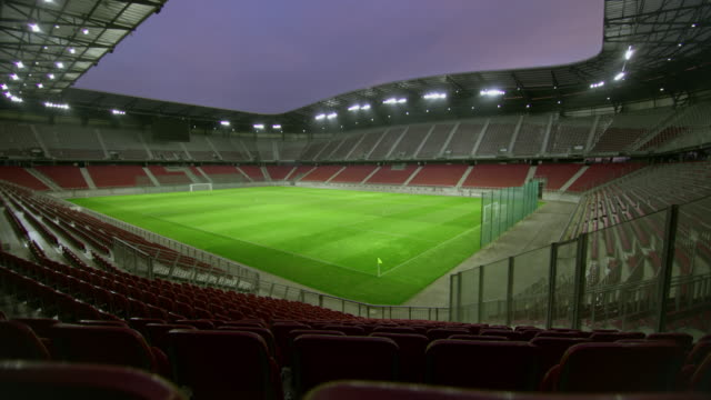ds empty football stadium in the evening - дворец спорта стоковые видео и кадры b-roll