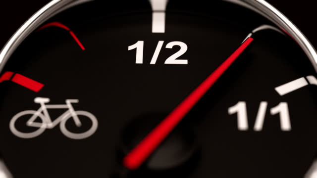 Empty fuel gauge with bicycle on the end. video