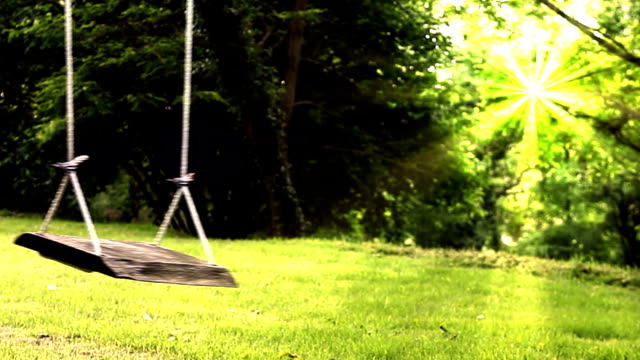 empty garden swing and woman. - family trees stock videos and b-roll footage