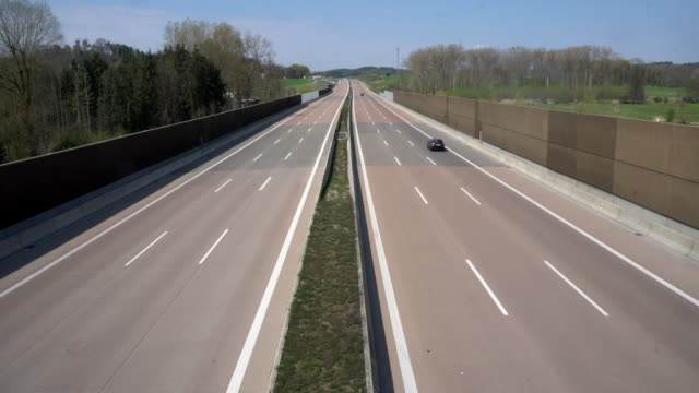 empty german motorway a8 thanks to exit restriction - autobahn video stock e b–roll