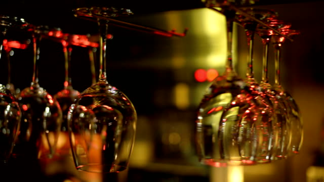 empty glasses for wine above a bar rack - bicchiere vuoto video stock e b–roll