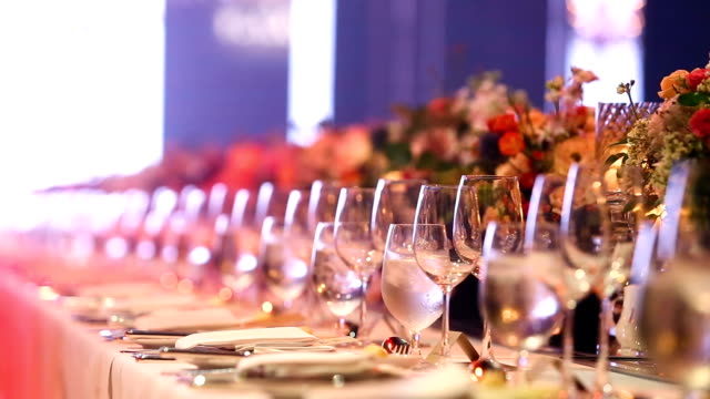 Empty glasses of champagne soft drink, soda and wine on Gala Dinner table, video