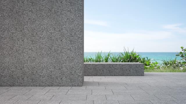 モダンなビーチハウスや豪華なヴィラの庭近くの屋外テラスにある空の灰色の小石の壁。 - デッキ点の映像素材/bロール