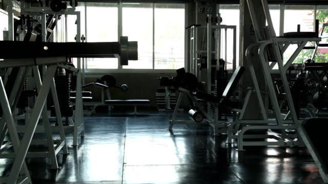 Empty gym. Empty gym with gym equipments, slider shot. health club stock videos & royalty-free footage