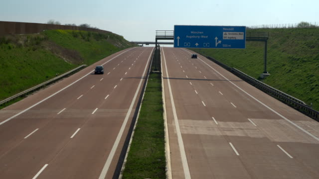 Empty highway with signposts
