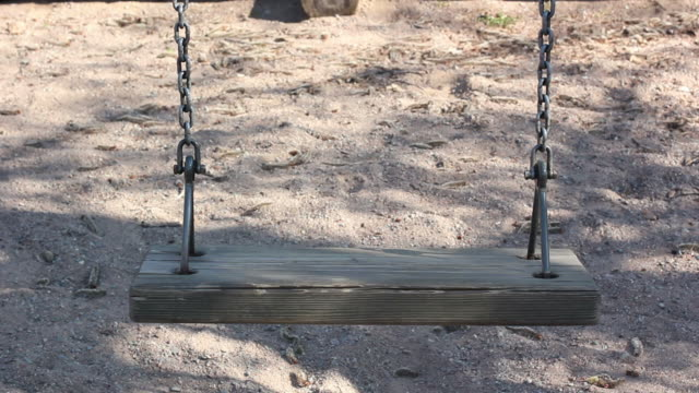 Empty, Lonely wooden swing at playground video