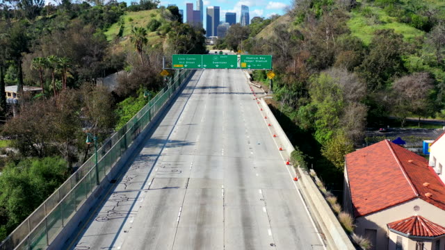 Empty Los Angeles Freeways during Coronavirus Pandemic Los Angeles California freeways empty during 2020 Coronavirus pandemic. barren stock videos & royalty-free footage