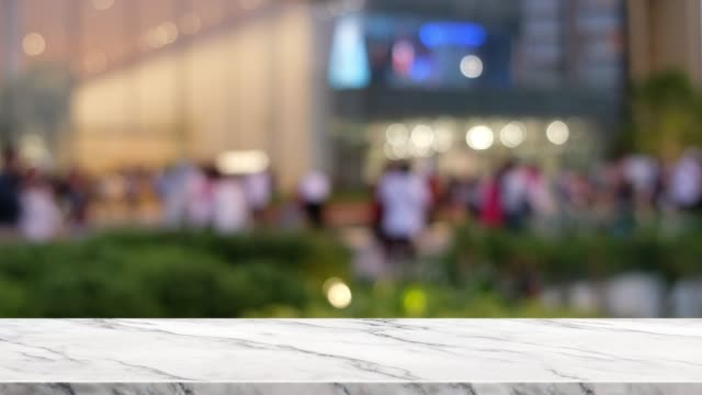empty marble table at blur people shopping at department store outdoor empty marble table at blur people shopping at department store outdoor market retail space stock videos & royalty-free footage