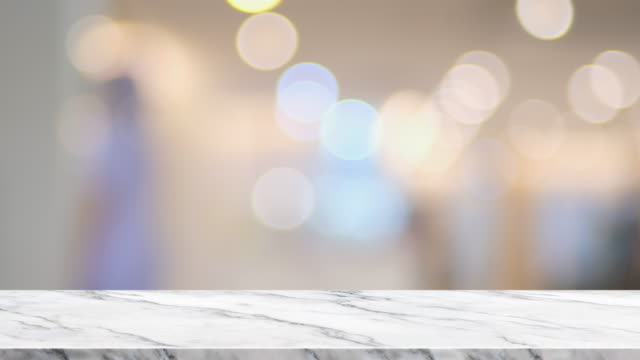 empty marble table with blur people at hospital bokeh light background.copy space for adding element or product - стол стоковые видео и кадры b-roll
