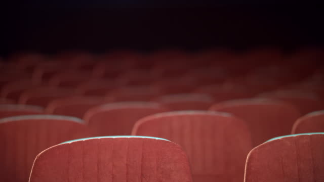 Empty movie theater auditorium with seats. Rows of void seats in cinema video