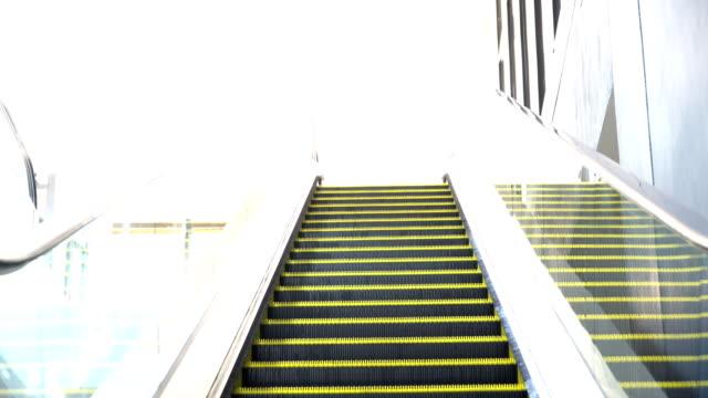 empty moving escalator running up