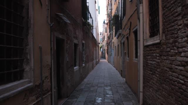 Empty narrow cozy street in Venice