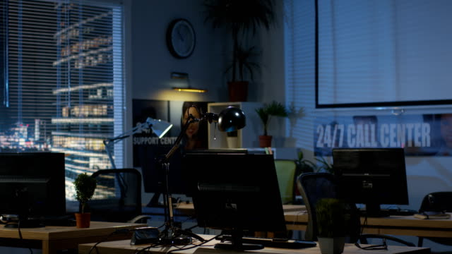 Empty office at night Medium shot of empty office at night office cubicle stock videos & royalty-free footage