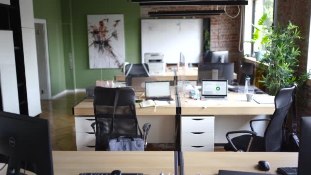 Empty office during lunch break Plexiglass panels between desks in an empty office office cubicle stock videos & royalty-free footage