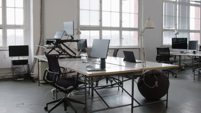 Empty open plan office with work stations