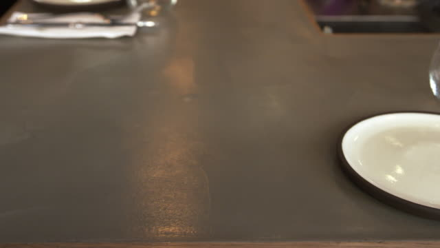 Empty place setting at a restaurant bar, camera slider shot video