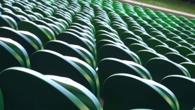 vídeos de stock e filmes b-roll de empty plastic seats in a stadium. matches to be played without fans. - estádio