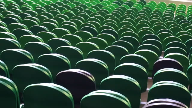 empty plastic seats in a stadium. matches to be played without fans. - дворец спорта стоковые видео и кадры b-roll