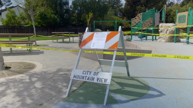 Empty playground in Mountain View, California at Coronavirus pandemic time. Empty playground in Mountain View (California) at Coronavirus pandemic time. March 27, 2020 Day time. The camera on the Steadicam. UHD 4K ProRes HQ 10 bit stay home stock videos & royalty-free footage