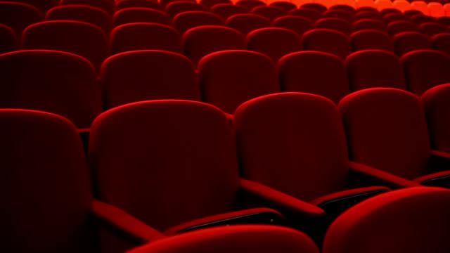 Empty red cinema or theater seats Empty red cinema or theater seats. lounge chair stock videos & royalty-free footage