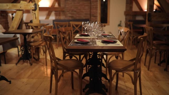 Empty restaurant with table set for dining