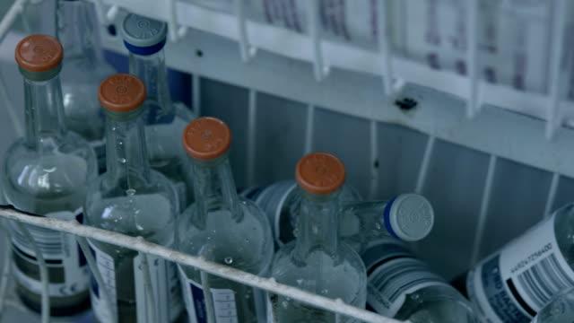 Empty saline bottles in the hospital video