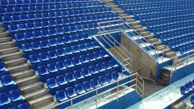 Empty seats in a stadium Empty seats in a stadium barren stock videos & royalty-free footage