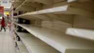 istock Empty shelves in store. Supermarket with empty shelves for goods 1210069811