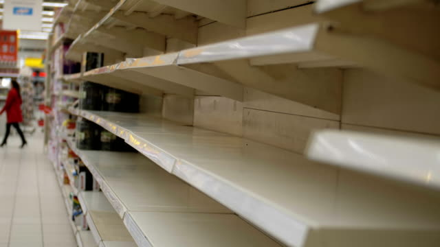 Empty shelves in store. Supermarket with empty shelves for goods