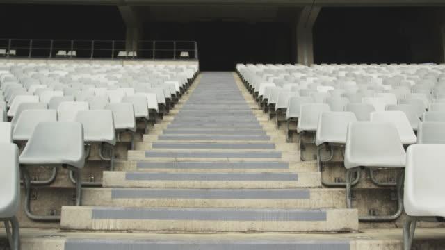 empty spectators seat in a stadium 4k - mebel do siedzenia filmów i materiałów b-roll