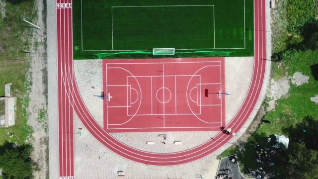 Empty sport playground  from birds eye view. Sport ground for playing big tennis, basketball, football, soccer, running.