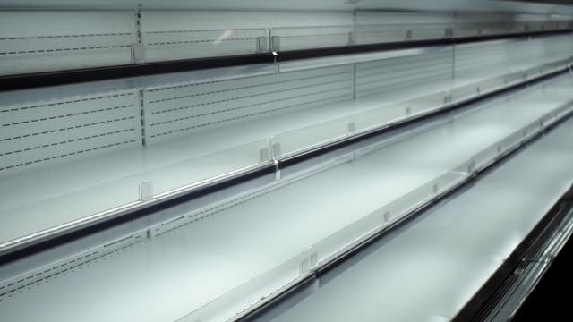 empty store shelves sale of goods sale empty storefront. the concept of black Friday shopping, the lack of goods market retail space stock videos & royalty-free footage