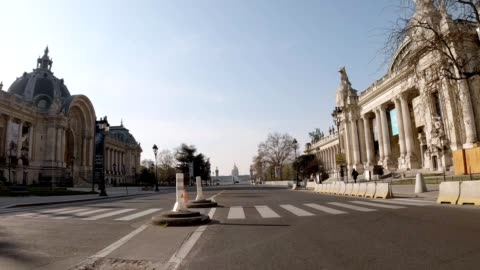 Empty street in Paris during lockdown Empty street in Paris during lockdown : view of Avenue Winston Churchill between Petit Palais and Grand Palais near Champs Elysees france stock videos & royalty-free footage