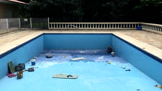 Empty swimming pool. Remodeling swimming pool Empty swimming pool. Remodeling swimming pool negative emotion stock videos & royalty-free footage