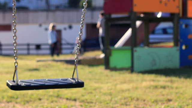 Empty Swing Swinging An empty swing swinging in the park. lost stock videos & royalty-free footage