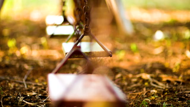 Empty swing Dolly shot video of Empty old swing in a playground (HD) swinging stock videos & royalty-free footage