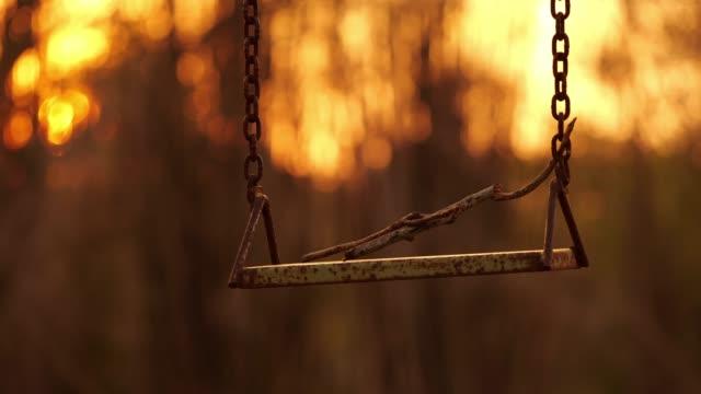Empty swings at sunset