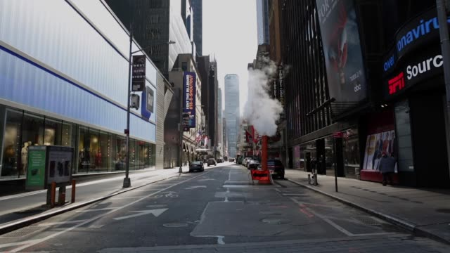 Empty Times Square and streets of Midtown New York City New York. March 27 2020. Virtually Empty Times Square and Midtown streets due to Coronavirus COVID-19 outbreak and Stay at Home regulation issued by Governor Cuomo barren stock videos & royalty-free footage