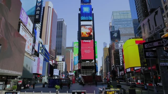 Empty Times Square and streets of Midtown New York City New York. March 27 2020. Virtually Empty Times Square and Midtown streets due to Coronavirus COVID-19 outbreak and Stay at Home regulation issued by Governor Cuomo famous place stock videos & royalty-free footage