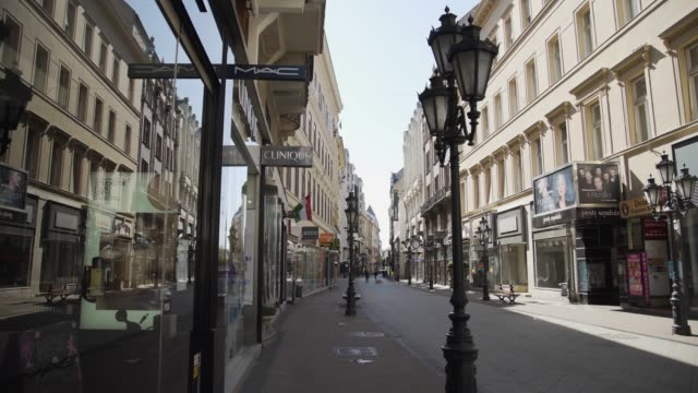 Empty Vaci Street, in Budapest. Business lines, bazaars, because of the coronavirus travel ban. Gimbal, steadicam smooth 4K shot. Empty Vaci Street, business lines, bazaars, because of the coronavirus travel ban. Nobody on the streets, no tourism in Europe. Gimbal, steadicam smooth 4K shot. hungary stock videos & royalty-free footage